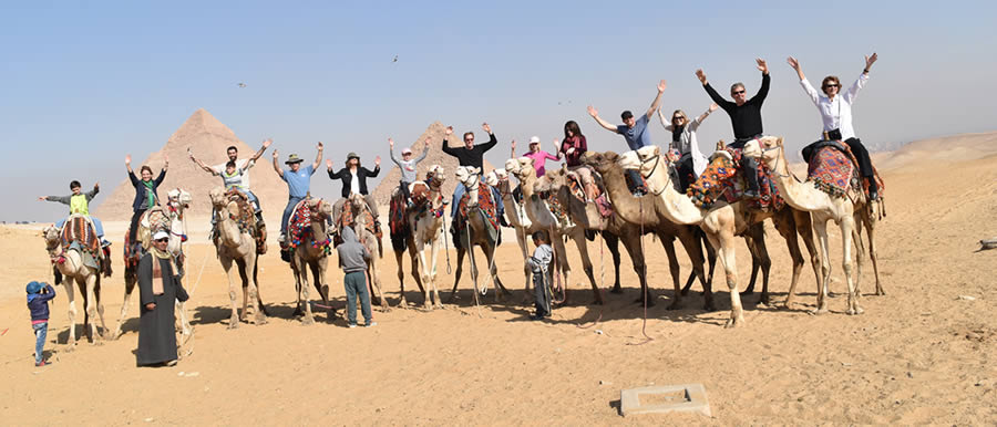 ISAP staff riding camels in Egypt